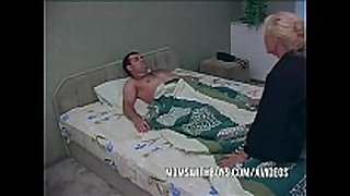 Blonde older waking stepson with a blowjob