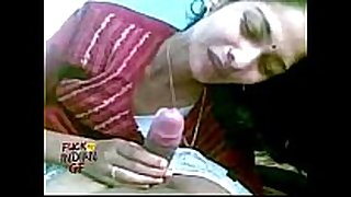 Indian cheating housewife engulfing giving her chap a blow job in...