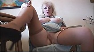 Curvy older black jock wench in nylons disrobes and positions