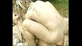 Muddy woman attacks and humps stud in the mud