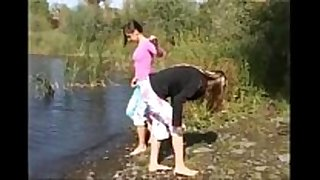 Two 18yo honeys undressed by the river