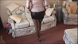Busty older chick in mini petticoat and nylons s...