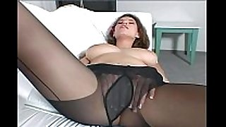 Busty dark brown milf teases in dark hose