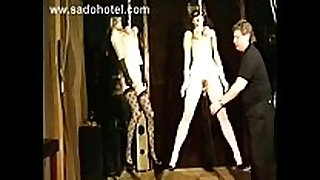 Two slave hangin on their titties on the ceiling a...