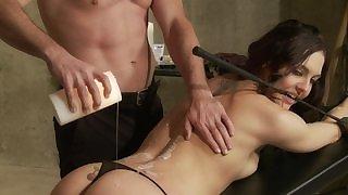Submissive brunette in black strings blows master's dick