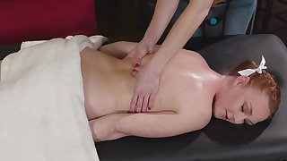 Cute redhead girl gets seduced and fucked by her kinky masseuse