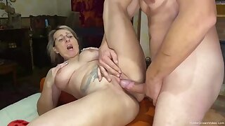 Blonde mature serves rock hard cock in front of the camera